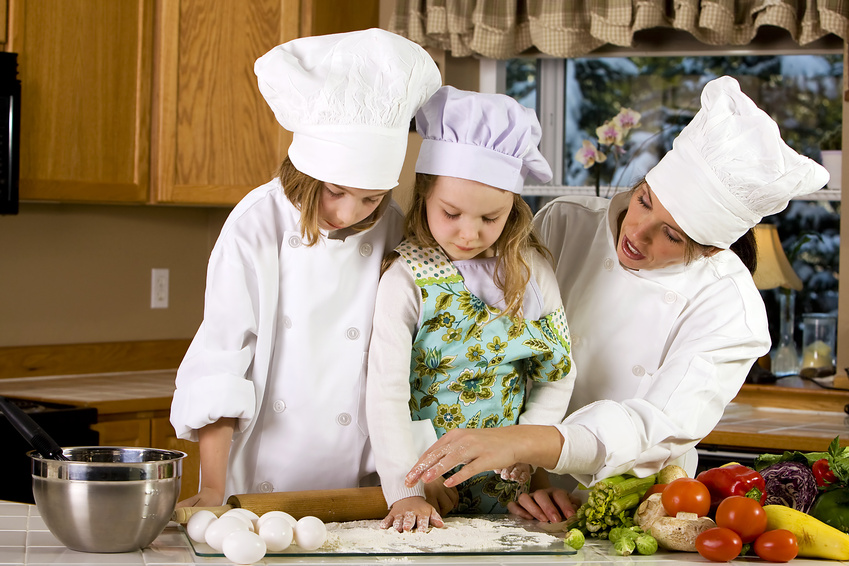 Mother teaching children how to cook